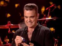 El desagradable gesto de Robbie Williams con sus fans durante un recital